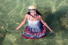 Woman in dress standing in the sea Royalty Free Stock Photo