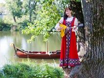 Woman in dress suit stylized Ukrainian folk Stock Image