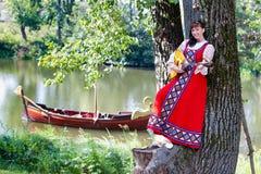 Woman in dress suit stylized Ukrainian folk Stock Photos