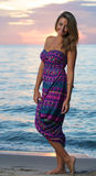 Woman in a dress at sunrise Stock Photo