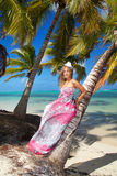 Woman in dress on tropical beach Stock Photo