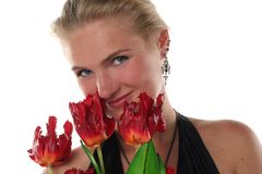 Woman in dress with tulips Stock Photo