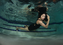 Woman in a dress underwater. Royalty Free Stock Photography