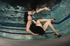 Woman in a dress underwater. Stock Image