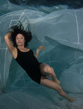 Woman in a dress underwater. Royalty Free Stock Photo