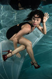 Woman in a dress underwater. Royalty Free Stock Images