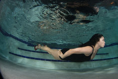 Woman in a dress underwater. Stock Photo