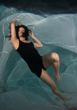 Woman in a dress underwater. Royalty Free Stock Photos