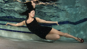 Woman in a dress underwater. Royalty Free Stock Image