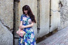Woman in dress walking in old town of Tallinn Stock Images