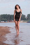 Woman in dress walking in sea Stock Photos