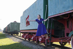 Woman at dress waving a scarf down Royalty Free Stock Photo