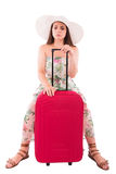 Woman in a dress on a white background A red suitcase Stock Image