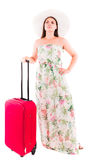 Woman in a dress on a white background A red suitcase Stock Images