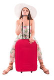 Woman in a dress on a white background A red suitcase Stock Photos