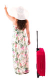 Woman in a dress on a white background A red suitcase Stock Photography