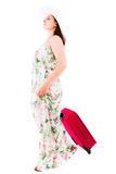 Woman in a dress on a white background A red suitcase Royalty Free Stock Photography