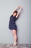 Woman in dress yawning and stretching Stock Images