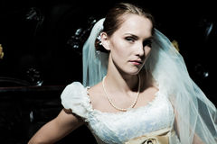 Woman dressed as a bride Stock Images