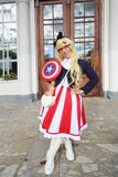Woman dressed as Captain America Royalty Free Stock Photos