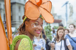 Woman dressed as flower. Smiling woman dressed as flower participating at the festival B-FIT in the Street, International Street Theater Festival on June 29 stock photo