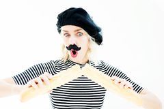 Woman dressed as a french man with beard and beret and baguette stock photos