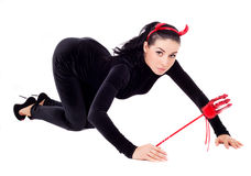 Woman dressed as an imp Stock Image
