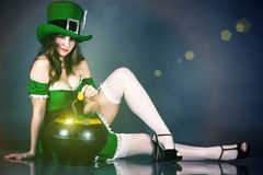Woman dressed as leprechaun. Gold hiding Stock Image