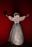 Woman dressed as Marie Antoinette. Woman wearing a Marie Antoinette costume looking very scared Royalty Free Stock Image