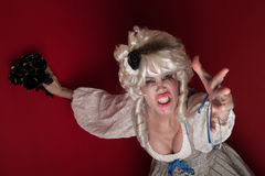 Woman dressed as Marie Antoinette. Woman wearing a Marie Antoinette costume appealing for her life Stock Image