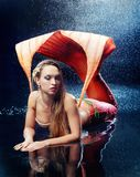 Woman dressed as mermaid. Beautiful model wearing a costume of a mermaid royalty free stock photo