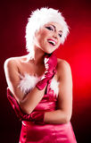 Woman dressed as Santa stock photos