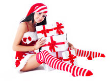 Woman dressed as Santa Stock Photo