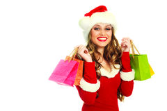 Woman dressed as Santa with bags Stock Photography
