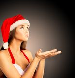 woman dressed as Santa blowing Stock Image