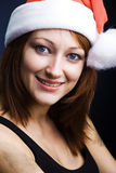 Woman dressed as Santa Claus Stock Image