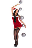 Woman dressed as Santa Claus holding a ball Royalty Free Stock Photo