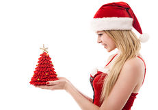 Woman dressed as Santa Claus holds a red gift Royalty Free Stock Photography