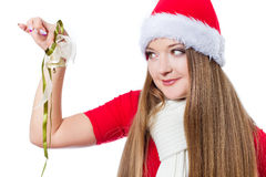 Woman dressed as Santa holding bell Stock Photos
