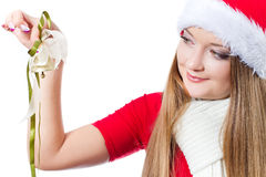 Woman dressed as Santa holding bell Stock Images
