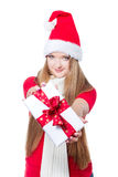 Woman dressed as Santa and holding xmas gift Royalty Free Stock Photos