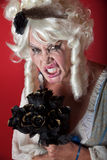 Woman dressed as scary Marie Antoinette. Woman wearing a Marie Antoinette costume Royalty Free Stock Images