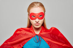 Woman dressed as a superhero with looking serious Royalty Free Stock Photos