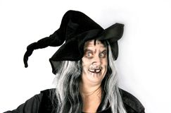Woman Dressed as an Ugly Witch. On White royalty free stock images