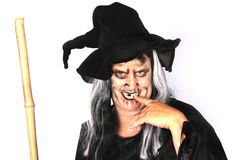 Woman Dressed as an Ugly Witch. On White stock photo
