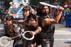 Woman Dressed As Xena Warrior Princess Poses At Dragon Con. Atlanta, GA, USA - September 5, 2015:  A woman dressed as Xena Warrior Princess and her sidekicks Stock Image