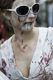 Woman dressed as a zombie parades on a street during a zombie walk in Paris. Royalty Free Stock Photography
