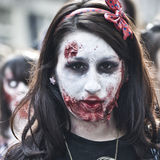 Woman dressed as a zombie parades on a street during a zombie walk in Paris. Royalty Free Stock Image