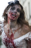 Woman dressed as a zombie parades on a street during a zombie walk in Paris. Stock Image