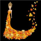 Woman dressed in autumn leaves Royalty Free Stock Photo